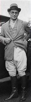 American diplomat and publisher John Hay 'Jock' Whitney (1905 - 1982) wears jodhpurs and riding boots.