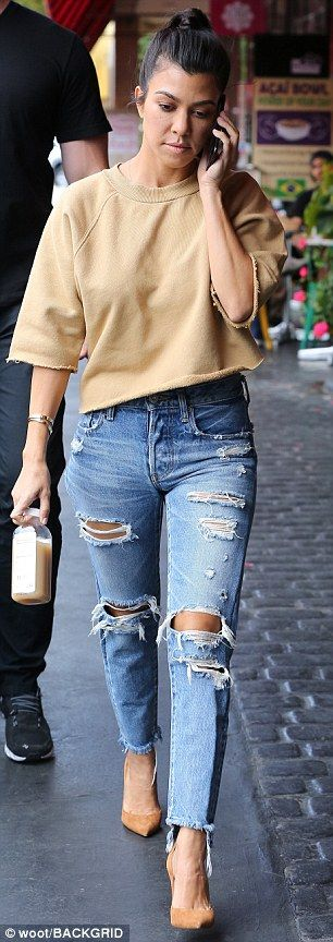 The eldest K girl: Kourtney also joined the besties; she carried a milk drink and talked on the phone as a bodyguard followed her