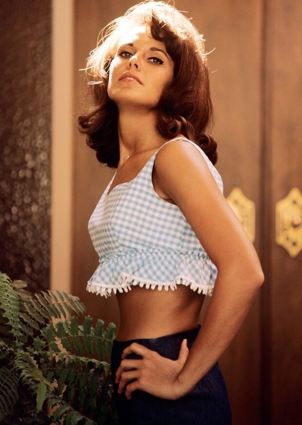 Lisa Baker was a 60s playboy bunny. This shot was taken in 1966. Vintage crop tops blue white fashion style model color photo print ad