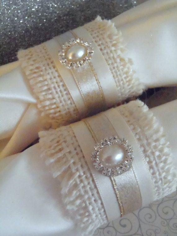 Fun and popular burlap napkin rings are perfect for the holidays including Thanksgiving, Christmas, New Years, Valentines, or even wedding reception or rehearsal dinners! This listing is for a set of 4 three-inch ivory burlap rings, with 1/2 cream satin ribbon around the center...then topped with golden ribbon and a beautiful pearl and rhinestone embellishment! They are fairly neutral, so will coordinate with most color schemes. Woo your family or your guests with lovely these little bea...