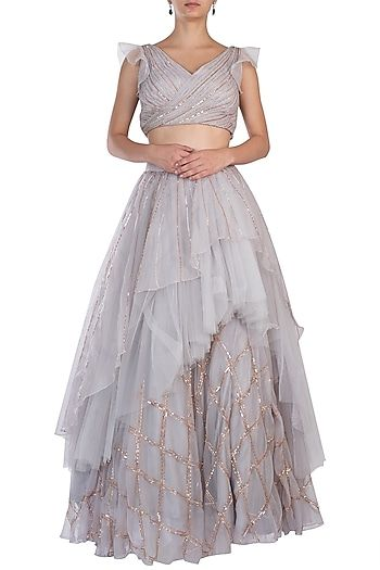 bf623a3d6b18 Pink Peacock Couture Featuring a grey pleated crop top in net base with 3D  rose gold handwork embroidery. It is paired with matching layered lehenga  skirt ...