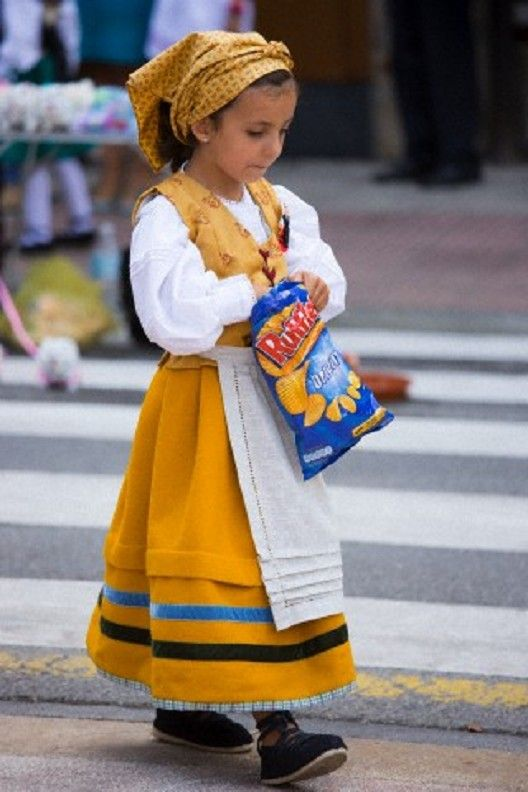 Little girl in Traditional outfit for the fiesta at Villaviciosa in Asturias, Northern Spain