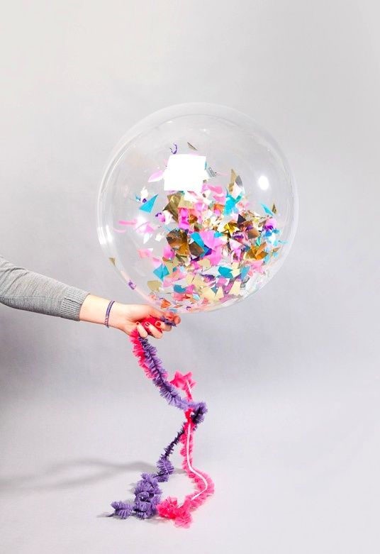 Fill balloons with confetti and pop at midnight. Great idea for a New Years Eve party!
