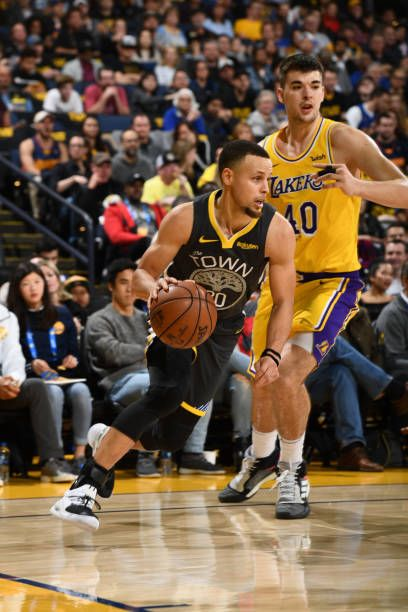 Stephen Curry of the Golden State Warriors drives to the basket against the Los  Angeles Lakers on February 2 2019 at the Pepsi Center in Denver. 491dcda43