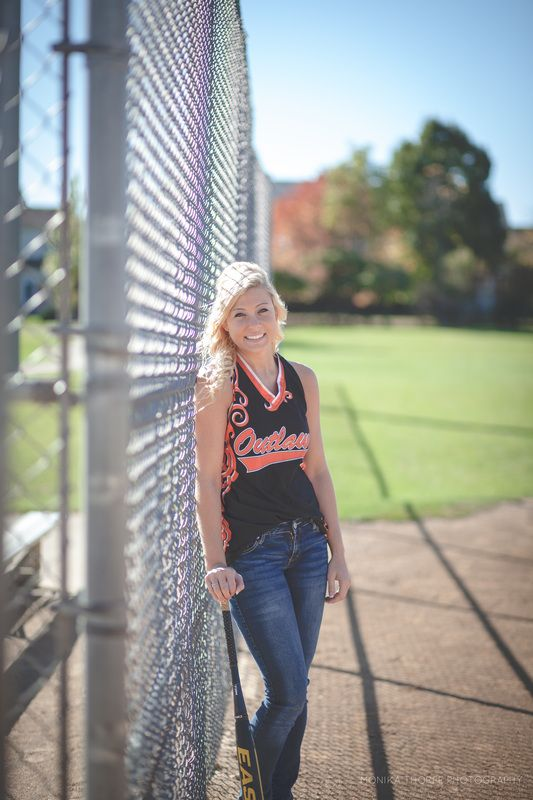 Softball Senior Photo Picture. I love that she's in jeans, take it with my hockey stick up against the goal cage
