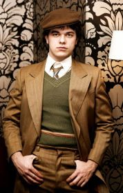 EXPOSITION: This is Nick Carraway, the narrator of the story. He is slightly less polished than the other men in the book.