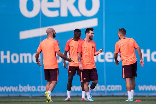 Javier Mascherano, Ousmane Dembele, Lionel Messi and Jordi Alba of FC Barcelona smiles during a training session ahead of the UEFA Champions League Group D match against Juventus on September 11, 2017 in Barcelona.
