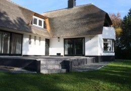 Prachtig huis met een heerlijk terras. Landelijk en stijlvol. Keramische buitentegels met natuursteenlook in Geesteren