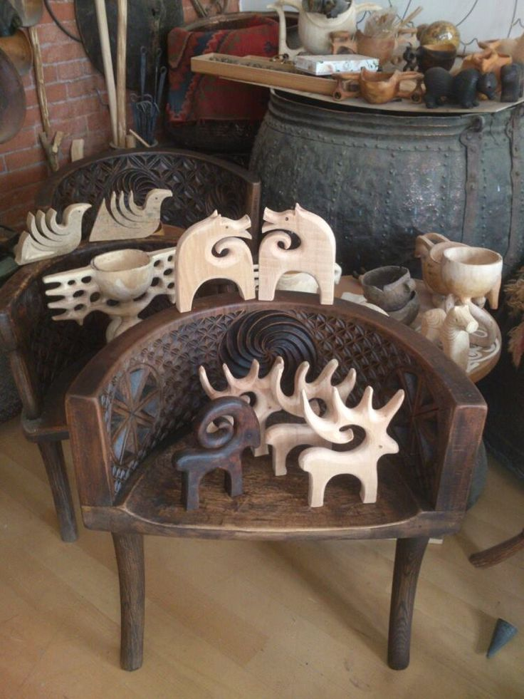 Traditional ethnic Ossetian toys and highchairs. Ceramics, metal, wood works of modern master Vadim Dzhioev from Vladikavkaz. It seems that in contemp