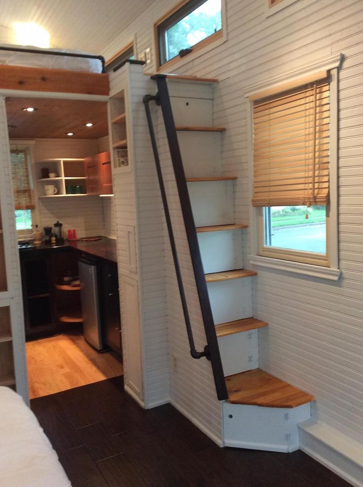 Although the treads on the staircase are a bit steep, this 250 sq ft house looks very functional. | Tiny Homes