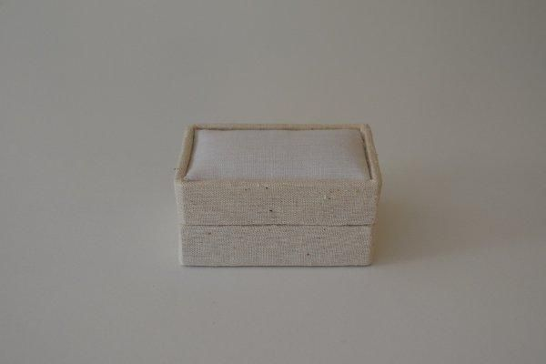 LBSrect.80 - Small Rectangular - Light Linen covered and lined boxes make it so easy for you to create a special gift or precious keepsake. Embellish your fabric as you desire, cover the removable, padded lid with your worked fabric and replace into the box lid. The box measures 9 x 6.5cm.
