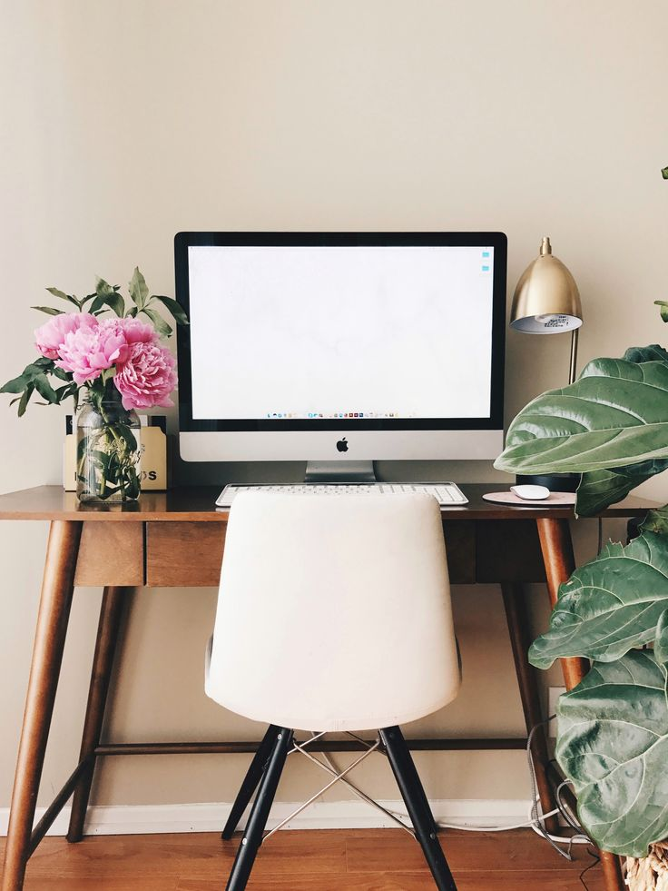 My mid century workspace featuring gorgeous pink peonies and Penny the fiddle leaf fig plant. Desk and lamp from @Target.