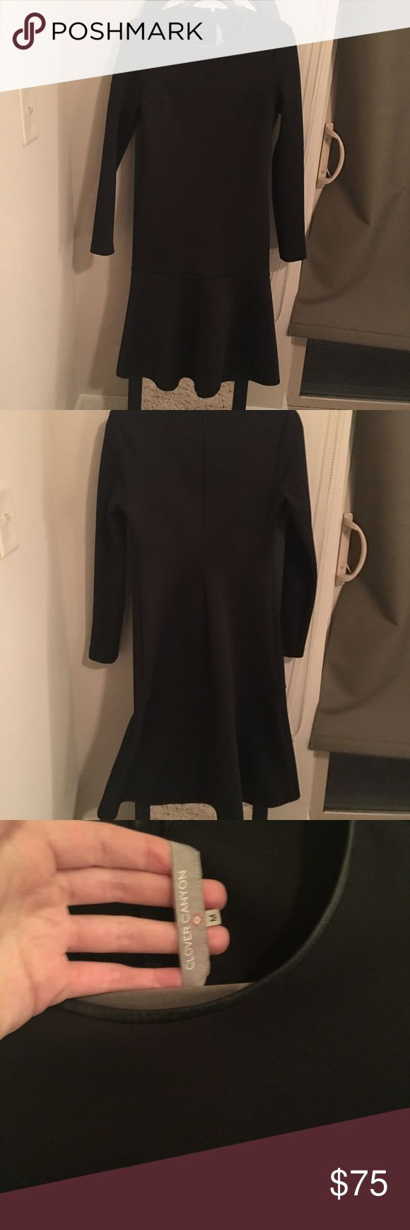 Clover Canyon Dress Stunning Clover Canyon black scuba midi dress size Medium. Long sleeve with a ruffle bottom. Leather trim on the collar. Form fitting throughout, with the ruffle at the bottom adding a bit of flare. Scuba fabric is very figure flattering. Like new condition, no tags. Clover Canyon Dresses Midi