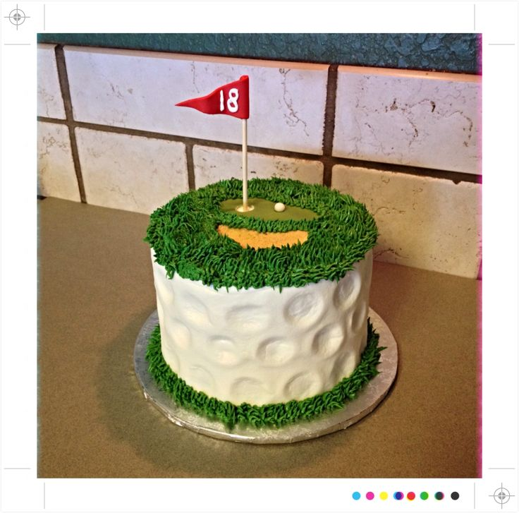 I like the contrast of the golf ball impression on the side of the cake with the green grass piped on the base and top.
