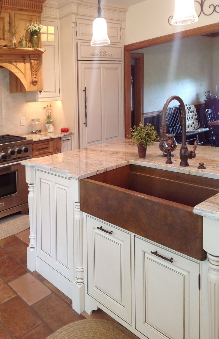 hundreds of photos of upscale kitchens showing copper and stainless steel sinks by rachiele get kitchen design ideas here: hammered copper kitchen sink