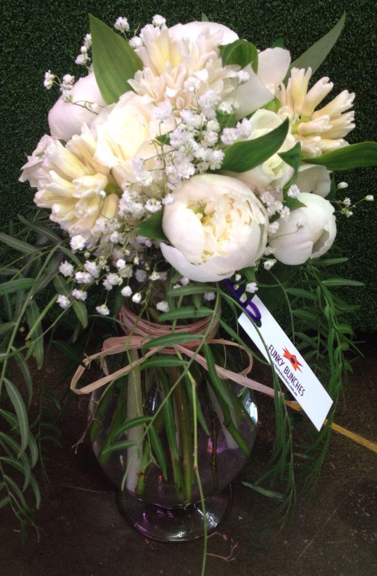 We love Soft romantic whites as a centrepiece.