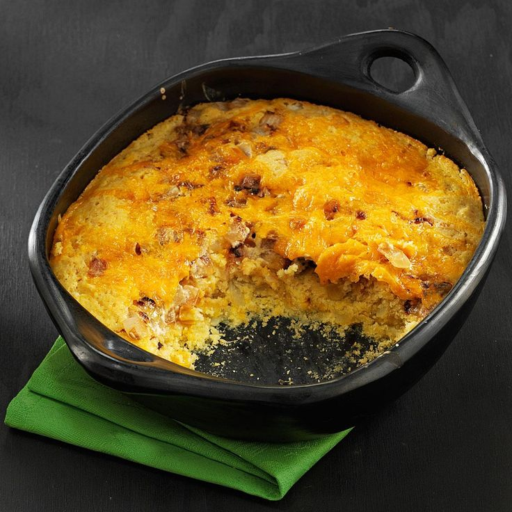 """Sweet Onion Spoon Bread Recipe -""""This unique recipe has been a family-favorite secret for years. The layers of tangy cheese, sour cream and sweet onions in this moist corn bread taste so great together!"""" Chopped green chilies could add some fun zip. —Heather Thomas, Fredericksburg, Virginia"""