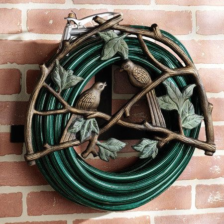 ideas amazing garden hose holder made from wrought iron materials and have decorative designs with birds ornaments garden hose storage