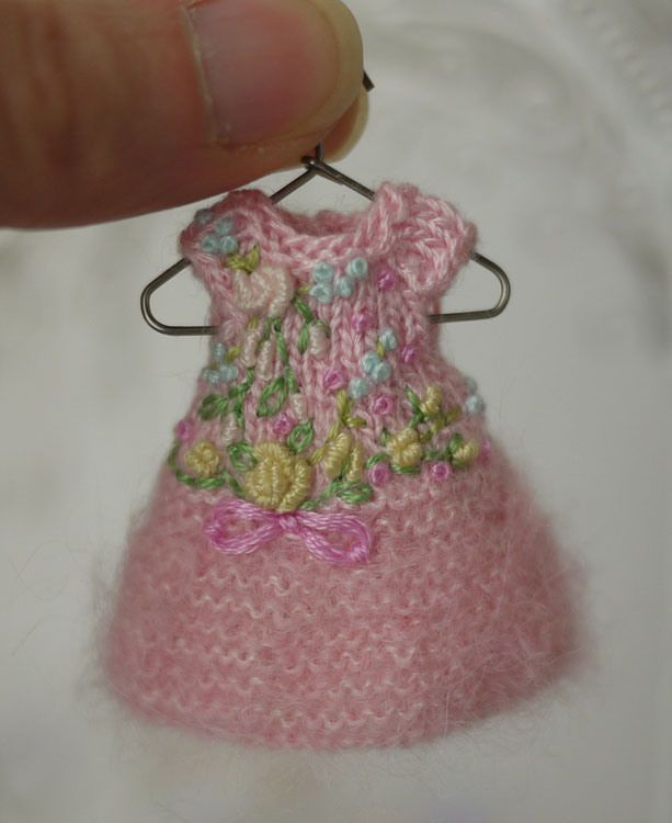 A hand knit and embroidered dress for Amelia Thimble dolls, bullion stitched roses, oyster knots, lazy daisy bow.