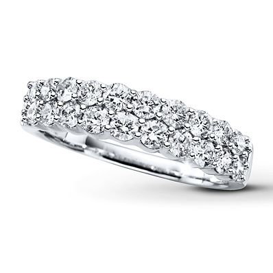Show her your love shines as brightly today as ever before with this exhilarating anniversary band for her. Two rows of dazzling round diamonds are set in lustrous 14K white gold. The ring has a total diamond weight of 1 carat. Diamond Total Carat Weight may range from .95 - 1.11 carats.