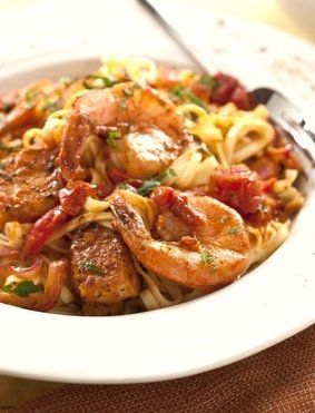 "This recipe was inspired by the #1 pasta dish at Cheesecake Factory, Cajun Jambalaya Pasta. Their menu describes it as ""shrimp and chicken sautéed with onion, tomatoes, and peppers in a very spicy Cajun sauce."" What it doesn't say is that the dish is as rich in oil, calories, and …"