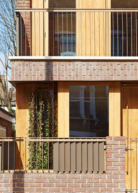 Haringey Brick House by Satish Jassal Architects   brick, metal louvre, + timber