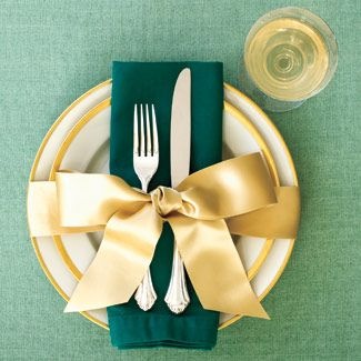 Bow Show: a simple yet stunning way to dress up your dining room for sit-down gatherings. It couldn't be quicker — just wrap each place setting with a length of wide, pretty ribbon. Do it in satin for a graphic statement, or in a loose organza for an elegant finish.