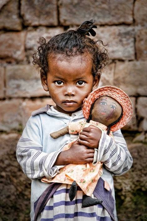 Madagascar © UNICEF/Pirozzi A girl holds a doll in a poor neighbourhood in Antananarivo, the capital. The country, beset by poverty, an isolated location, natural disasters and an ongoing political crisis, is one of the poorest in the world. ♥ www.jsimens.com - helping families worldwide