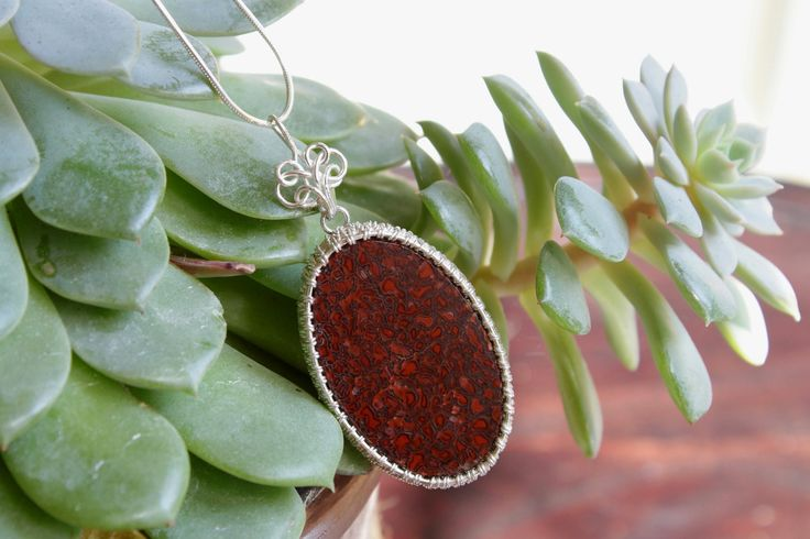 Dinobone Pendant (with silver chain) by designbyeSKay on Etsy