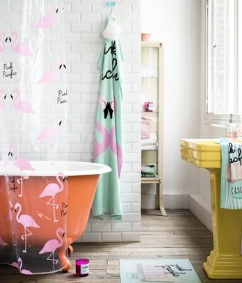 bathroom / transparent curtain / yellow sink / orange / white / brick / wall