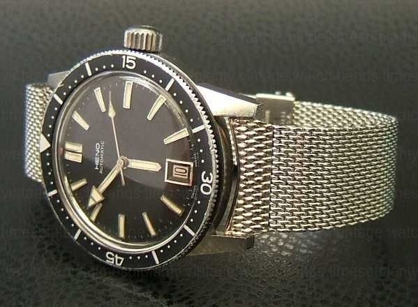 Here's a 1960s Heno Compressor watch I used to own with a ...