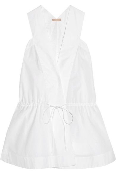 Azzedine Alaïa is responsible for dressing some of the world's most glamorous women - including Madonna, Naomi Campbell and Carine Roitfeld. Part of his Spring '17 collection, this white top is cut from airy cotton-poplin with wrap-effect front and an adjustable drawstring to define your waist. We love it styled with skirts and sneakers.