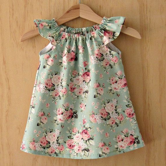05ea040a5889 Very pretty little girls vintage green and pink rose print cotton flutter  sleeve peasant dress, with a matching elasticated knotted bow headband.