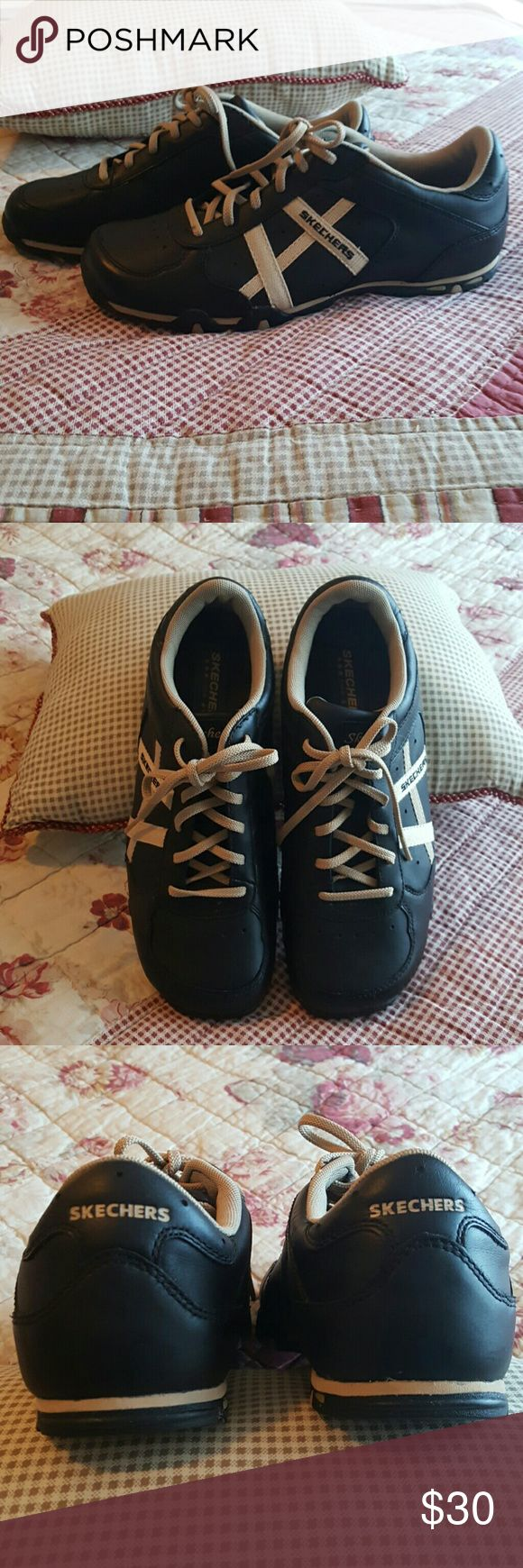Sketchers Tennis Shoes NWOT. Never worn.  Black with tan lines on the outside of the shoe. Skechers Shoes Sneakers