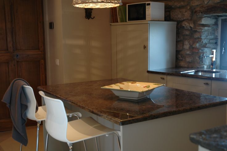 Kitchen with granite work tops.  A great place to enjoy your morning cappuccino !