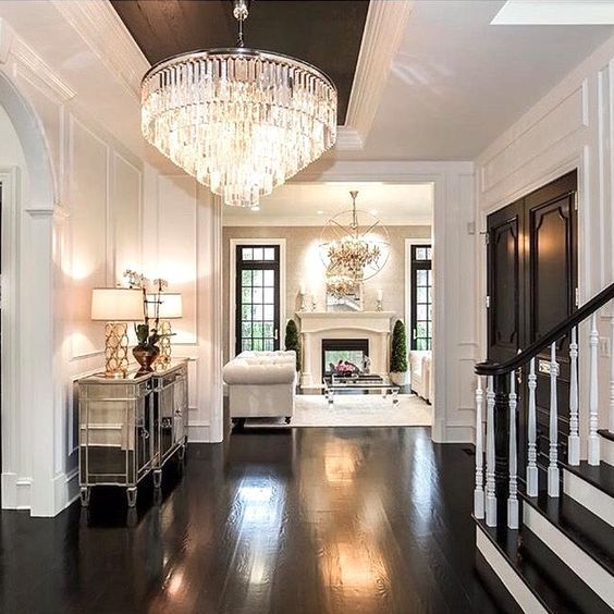 Amazing Foyer! Love the dark and white wood together