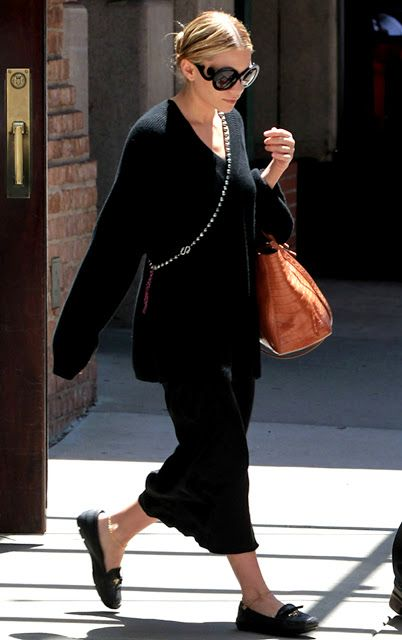 Love the outfit with the beads cross body. Very chic!