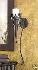 Oude middeleeuwse achtige decoratie.... zoals kandelaren voor aan de muur of op tafel of.....
