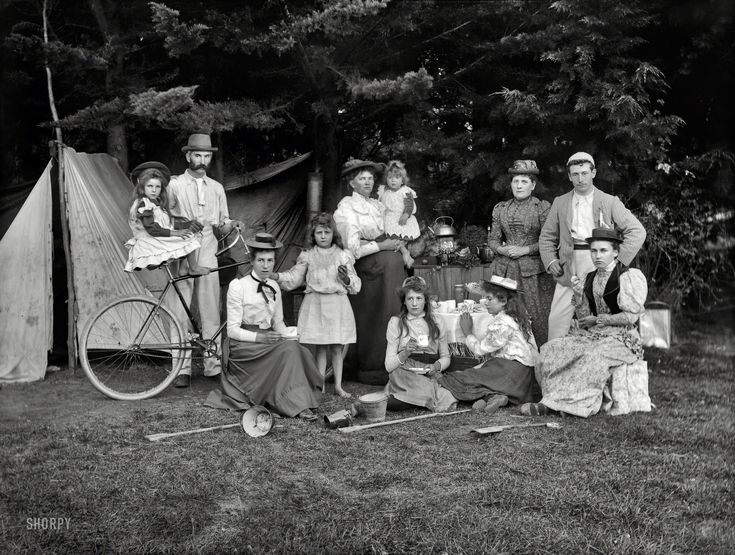 """New Zealand circa 1910. """"Unidentified group outside a tent, possibly at Sumner, Christchurch."""" Glass negative by Adam Maclay."""