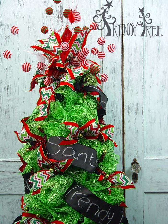 Christmas tree made with a tomato cage - see the tutorial here: http://www.trendytree.com/blog/turn-tomato-cage-christmas-tree/