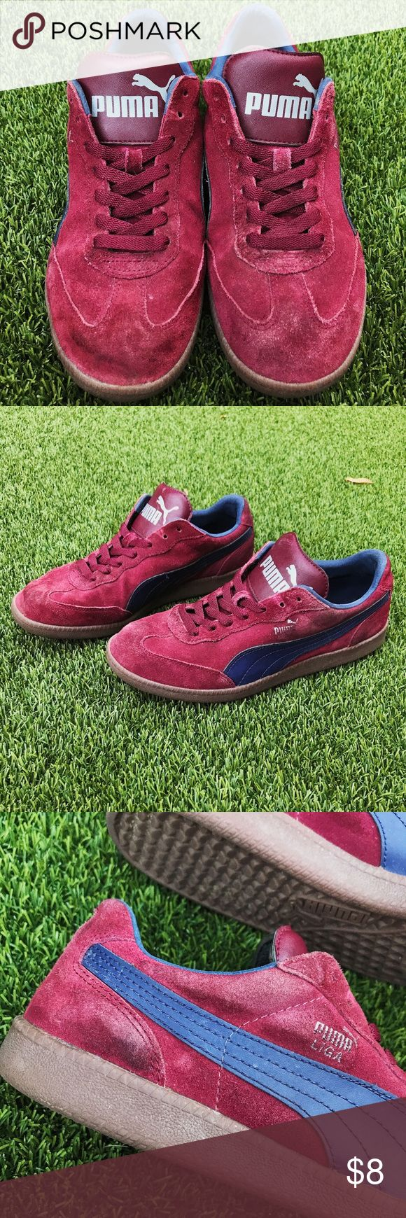 Vintage-Style Puma Liga Maroon and Navy Sneakers These retro style men's shoes in a burgundy and navy blue color are quite worn in— giving them even more of a vintage feel. As you can see from the pictures they are well loved. As with all Pumas they have lots of life left in them. They are sold as is and the buyer understands that these shoes are well worn. Puma Shoes Sneakers