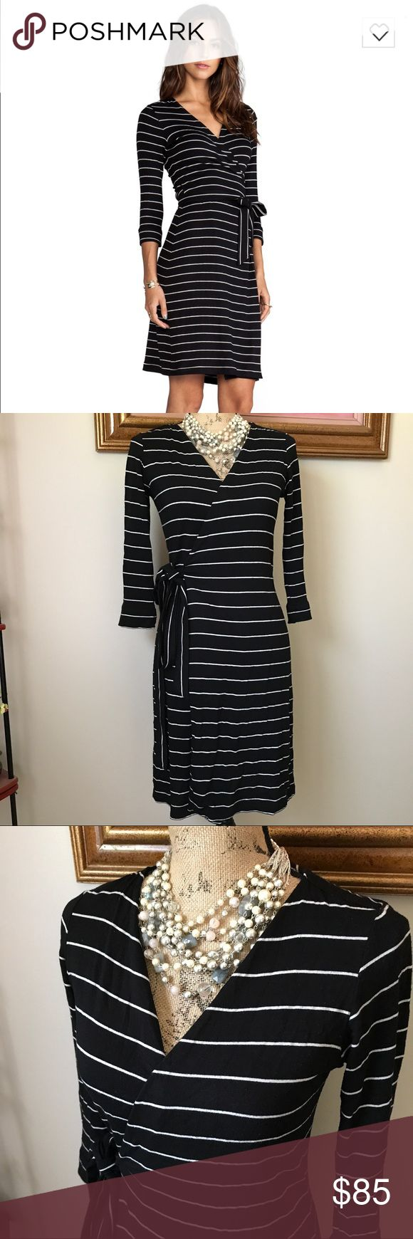 """Saint Grace Stripe Wrap Dress Beautiful Moby Dylana stripe wrap dress. 81% rayon, 13% poly, 6% lycra. Shoulder swam to hem measures approx 34"""". This dress is simply yet sophisticated! Size small. Saint Grace Dresses Long Sleeve"""