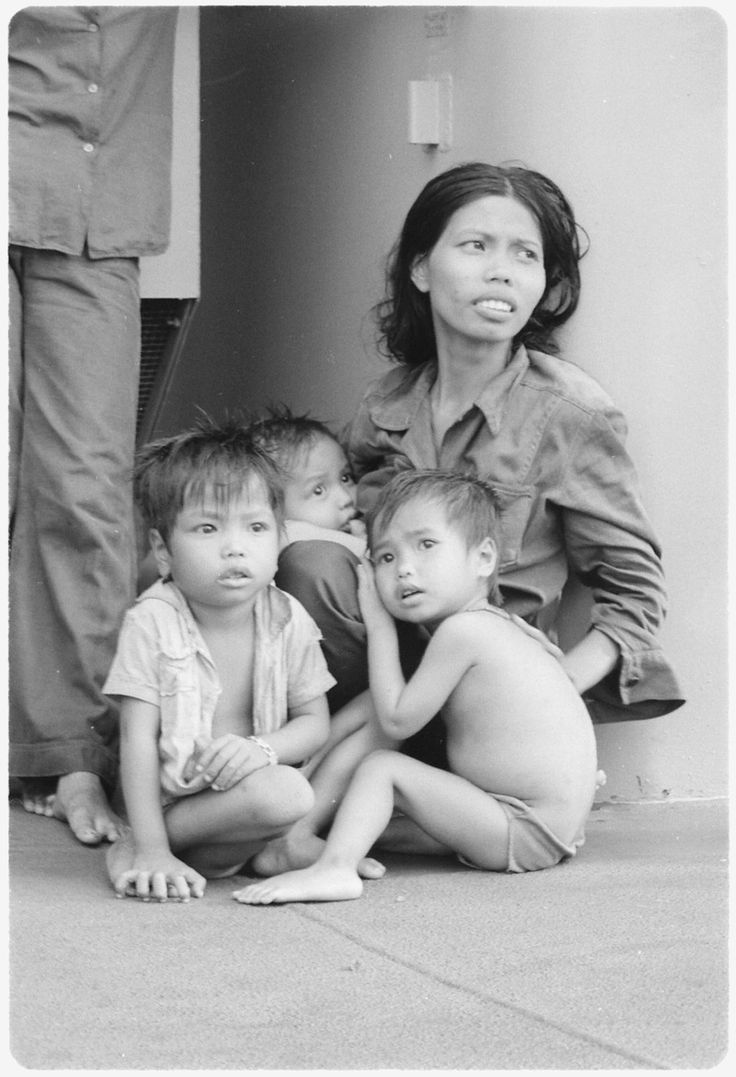 Aug 5, 1979 South China Sea....A refugee woman cares for three small children on the replenishment oiler USS Wabash, AOR-5.... - NARA - 558538 - Vietnamese boat people - Wikipedia, the free encyclopedia
