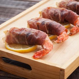 Prosciutto-Wrapped Shrimp with Goat Cheese Filling, a recipe from ATCO Blue Flame Kitchen's From the Grill 2014 cookbook.