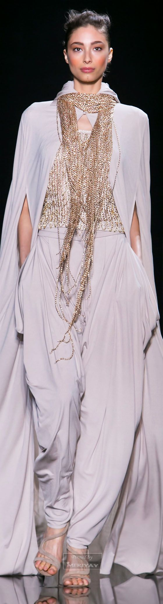 Loris Azzaro. Spring 2015 Couture--In an apparent triumph for Armani, draped and flowing looks are becoming more prevalent this spring.
