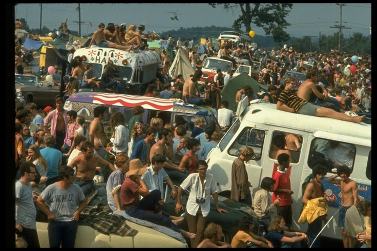 """""""For a few days in August 1969, on a dairy farm in upstate New York, a half-million young people got together to hang out, dance, and listen to music at what became one of the defining events of the '60s. For LIFE photographer John Dominis, covering the festival became one of the most moving adventures of an amazing 25-year career."""" (LIFE)"""