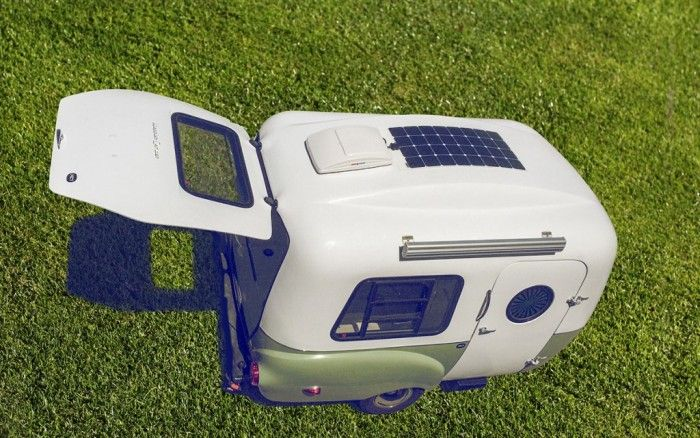Happy Camper Solar The Happier Camper is a different kind of pull-behind. At just 1,100 pounds, you can tow it behind a lot of small cars,