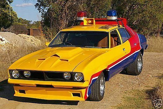 "Mad Max's Yellow Interceptor (4 Door XB Sedan). This car is a Ford Falcon XB sedan, 351 V8 engine, probably a 1974 model. Max is seen driving this car before he goes ""Mad"", and takes off in the black Interceptor."