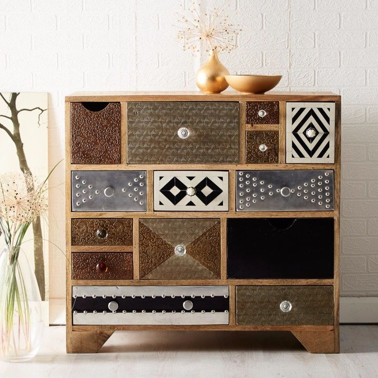 Hand crafted from reclaimed wood and metal, our Surat Multi Drawer Chest blends gorgeous aesthetics with superb functionality. With its unique and distinctive style, the Surat Collection fuses striking gold, silver and bronze detailing with 100% reclaimed...