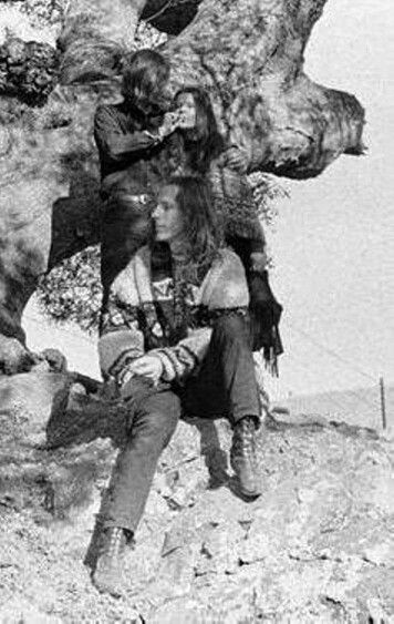 Janis takes a hit, with big brother, Woodacre CA., 1967.  Sam Andrew standing with Janis and James Gurley sitting.